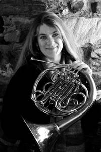"Lydia Busler-Blais, Horn Soloist & Lyric Improvisationalist, Modern & Chamber Musician with the Starlight Horn Duo and Heritage Brass: ""I am not a fickle with horns. As a soloist and improvisationalist, I demand more color, nuance, complexity, and flexibility from a horn than most players. As a principal hornist, I also need power and accurancy. I regularly have my pick of a large number of wonderful horns because I am the Exhibit Coordinator/Vendor Liaison for the Northeast Horn Workshops, so I must try them all. I had not purchased a horn in many years that could meet my requirements for coloration, subtlety, and the power to get to the back of the hall without hitting a wall on stage. When I got to test the LDx5 in a performance of Titanic, I was in love. I ordered my own right away with a hand-hammered bell. Yes, I so love and value my LDx5 that I named this horn Wotan."""